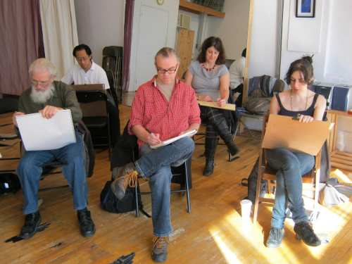Artists sketch Jillian Page in a Figure Drawing workshop in Montreal on Oct. 20, 2013. Colette Coughlin, one of the workshop organizers, is seen sitting in the background, in grey top. Photo taken by Jillian Page during a pose.