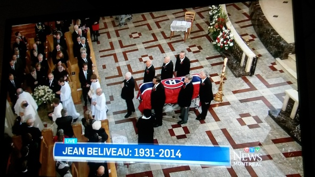 In this image taken from CTV News coverage, pallbearers who included Habs legends Guy Lafleur (top right) and Serge Savard (lower left) prepare to wheel Jean Béliveau's casket out of Mary, Queen of the World Cathedral after his funeral on Wednesday, Dec. 10. (Photo: CTV News/Jillian Page)