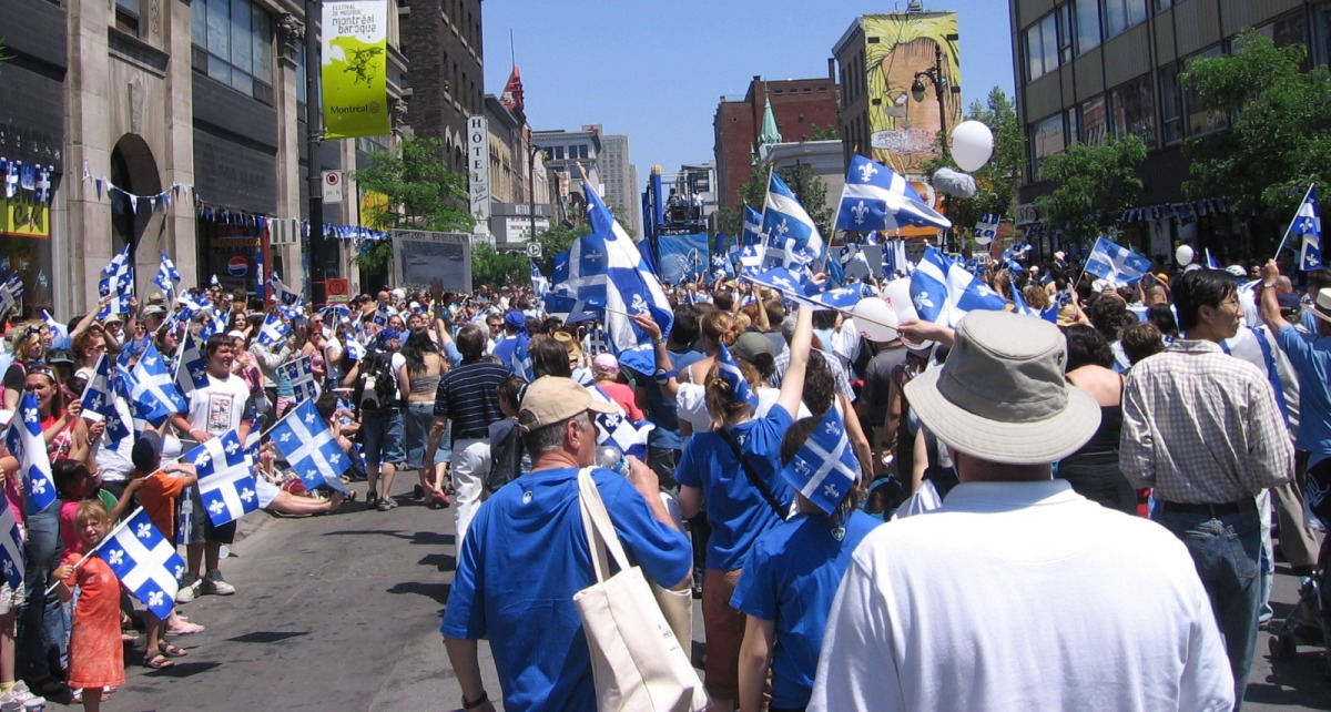 Fête National parade in downtown Montreal. (Source: Wikimedia Commons)