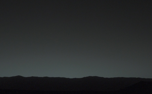This view of the twilight sky and Martian horizon taken by NASA's Curiosity Mars rover includes Earth as the brightest point of light in the night sky. Earth is a little left of center in the image, and our moon is just below Earth. (Photo: NASA)